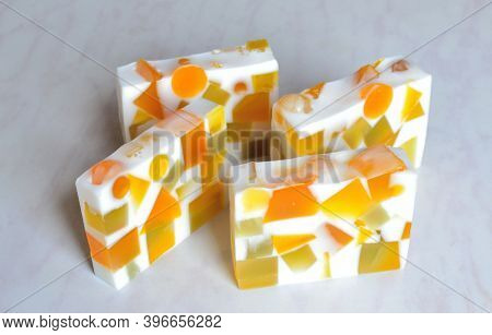Four Pieces Of Original Handmade Soap With Splashes Of Geometric Shapes