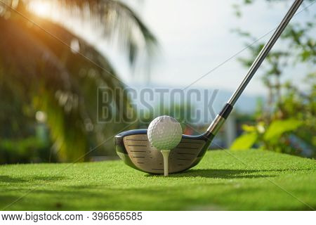 Golf Balls On The Golf Course With Golf Clubs Ready For Golf In The First Short. In The Morning, Wit