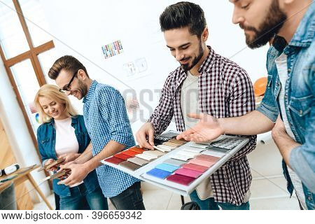 Team Of Designers Architects Look At Color Swatch.