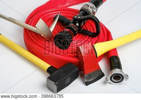 Large Yellow Sledgehammer, Axe, Hooligan Pinch-bar And Rolled Fire Hose From Firemans Toolbox On Whi