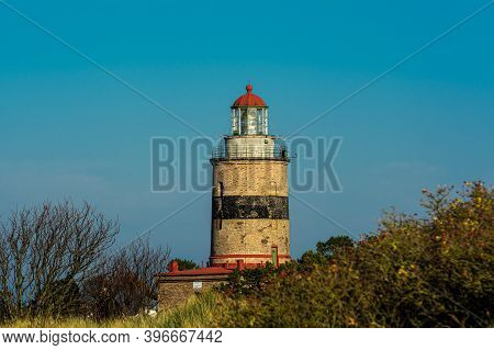 A Brick Lighthouse With A Bright Blue Sky In The Background. Picture Of Falsterbo Lighthouse Built I