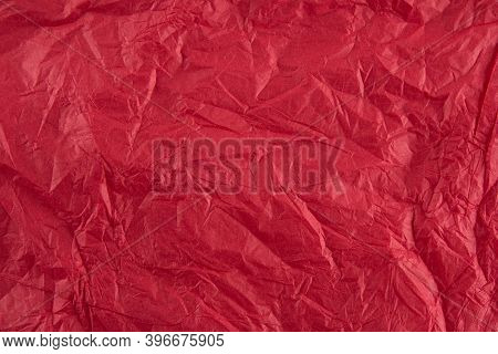Background With Red Crumpled Sheet Of Fabric With Vignetting