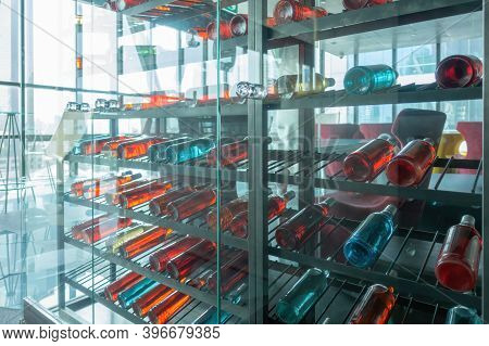 Alcohol Beverage. Colorful Sparkling Wine And Champagne Bottles Collection In Bar On Rack Shelves. P