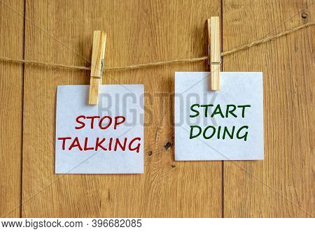 Time To Start Doing. Wooden Clothespins With White Sheets Of Paper. Text 'stop Talking Start Doing'.