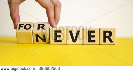 Forever Or Never. Male Hand Flips Wooden Cubes And Changes The Word 'never' To 'forever'. Beautiful