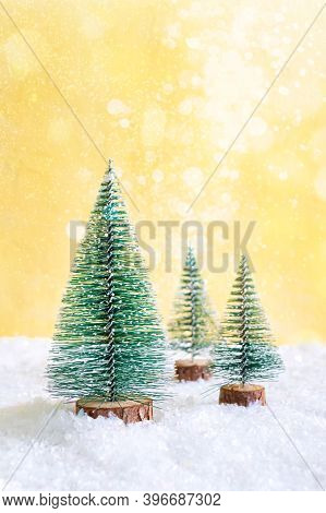 Christmas Toy Trees In Snowdrift. Beautiful Festive Background With Lights For Web, Print. Copy Spac
