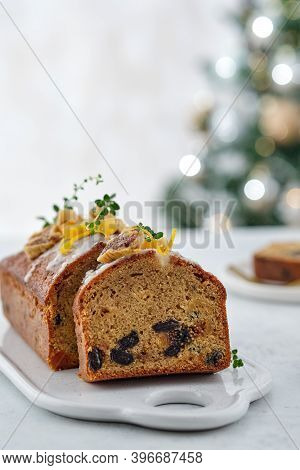Beautiful Delicious Homemade Christmas Dried Fruit Cake On Grey Table With Decorating Items For Cele