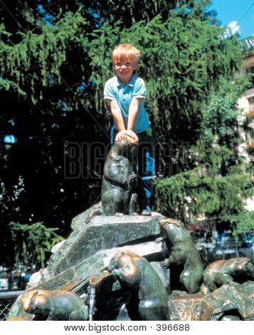 Boy On Statue