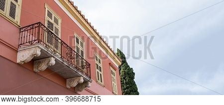Neoclassical Building Facade Detail, Cloudy Sky Background, Plaka, Athens Greece