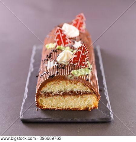 chocolate yule log christmas cake and decoration