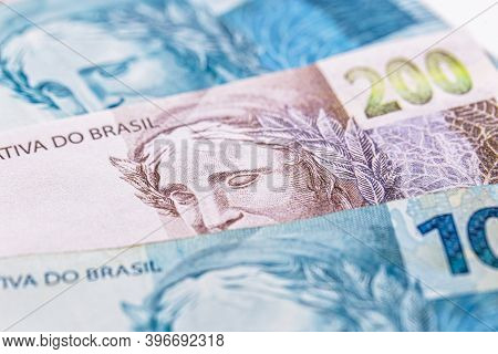 One Hundred And Two Hundred Reais Bills, Money From Brazil. Concept Of Economic Crisis In Brazil, Pr