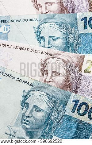 One Hundred And Two Hundred Reais Bills, Money From Brazil. Payment And Credit, Profit Or Wealth Con