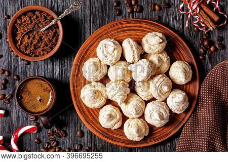 Meringue Cookies Served On A Plate With Christmas Sugar Cane, Coffee Cups, Coffee Beans, Brown Sugar