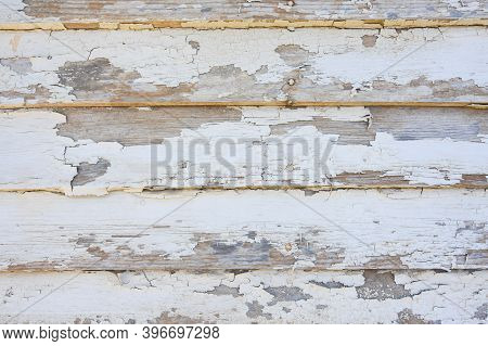 Wood Plank Siding With Peeling Paint From An Abandoned General Merchandise Store In Tennessee