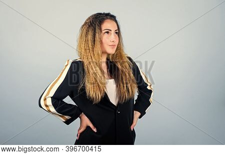 Mixing Elegant And Athletic Pieces. Sportswear Set Rules On Catwalks. Voluminous Crimped Hairstyle.