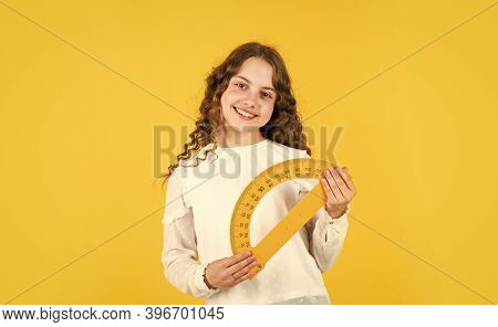She Loves Studying. Small Girl Holding Protractor For Geometry Lesson. Back To School. Student Learn