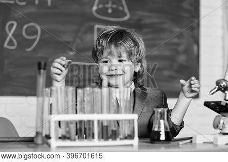 Kid Study Chemistry. Biotechnology And Pharmacy. Genius Pupil. Education Concept. Wunderkind Experim