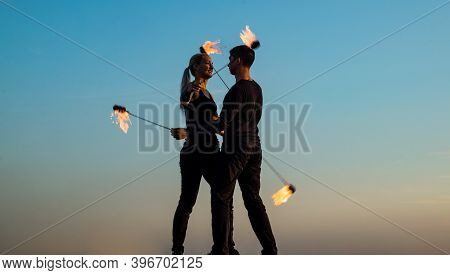 Sexy Couple In Love Dance While Spinning Burning Poi Blue Sky Outdoors, Fire Show