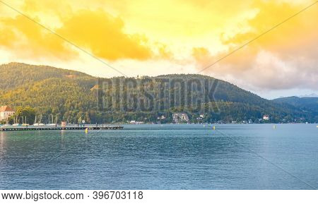 View Of The Alpine Lake Worthersee, Famous Tourist Attraction For Swimming, Boating, Sunbathing And