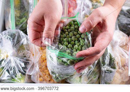 Frozen Green Peas. Frozen Vegetables In A Plastic Bag In Freezer