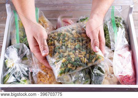 Frozen Green Beans. Frozen Vegetables In A Plastic Bag In Freezer