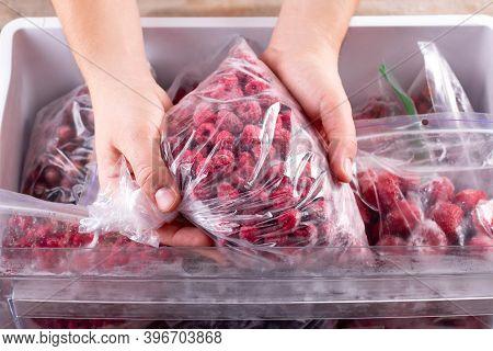 Frozen Raspberries. Frozen Berries And Fruits In A Plastic Bag In Freezer