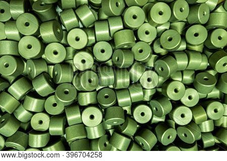 Full Frame Batch Of Aluminium Cylinder Parts After Anodizing With Filling In Green Chromate Solution