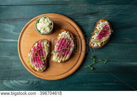 Toasts From Sliced Watermelon Radish With Chinese Daikon, Cottage Cheese And Microgreen. Food Recipe