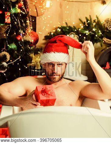 Im Waiting. Happy New Year Gift. Erotic Wish. Feel Temptation. Muscular Man Relax Bathtub. Best Xmas