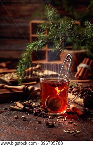 Christmas Herbal Tea With Cinnamon, Anise, And Dried Herbs. Herbal Tea With Juniper Twig On An Old B