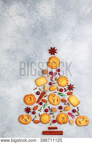 Culinary Background Of Sugar Cookies, Almonds And Spices In The Form Of A Christmas Tree. Delicious
