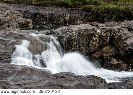 Small Waterfalls Near Fairy Pools In Glen Brittle, Isle Of Skye, Scotland, Uk Taken With Long Exposu