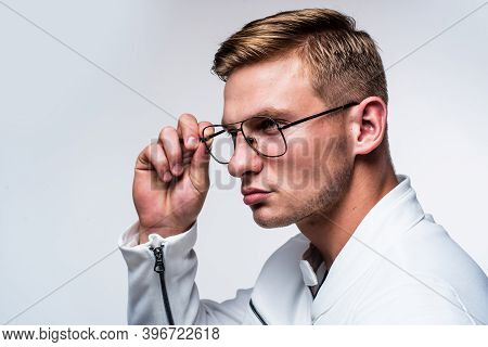 Fashion Eyewear You Want To Wear. Serious Man Fix Glasses Isolated On White. Trendy Eyeglasses. Visi
