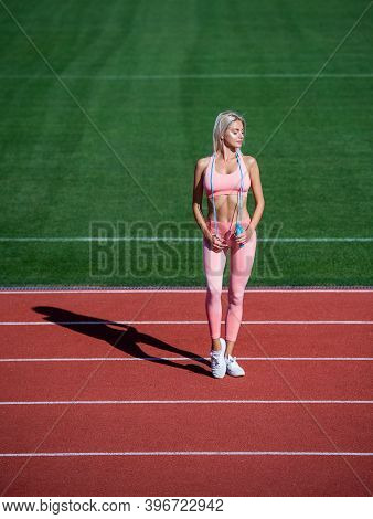 Energy Inside. Female Athlete Do Jumping Sport Workout. Trainer Or Coach Training With Skipping Rope