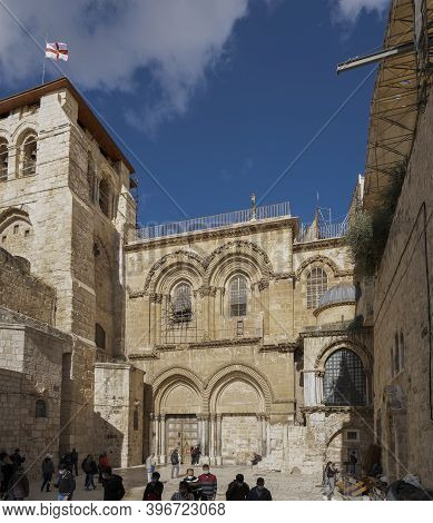 Jerusalem, Israel - November 21st, 2020: Tourists Wearing Protective Masks Outside The Church Of The