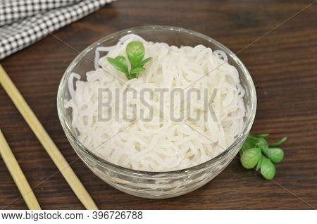 Konjac Or Shirataki Noodles With Chinese Chopsticks. Japanese Traditional Dish. Healthy Food For Wei
