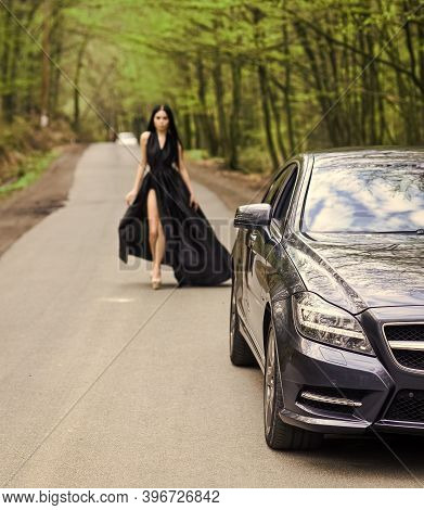 Driver Girl. Beauty And Fashion. Woman In Black Dress. Elegant Lady Escort Service Worker. Sexy Girl