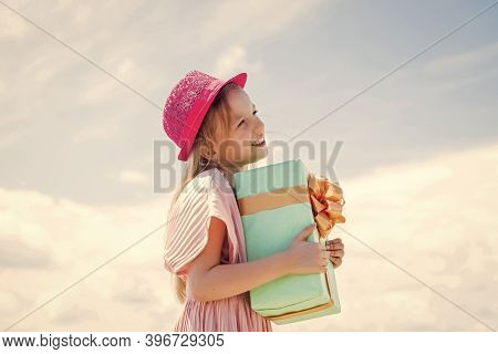 Thanks For Your Purchase. Joyous Female Kid Holding Gift-wrapped Box. Holding Gift In Hand. Smiling