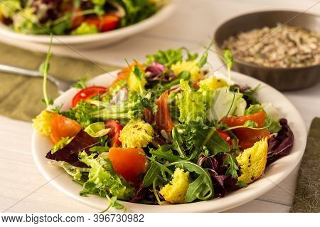 Light Breakfast Or Dinner, Mix Salad With Salmon And Different Seeds, Plate With Salad And Cornbread