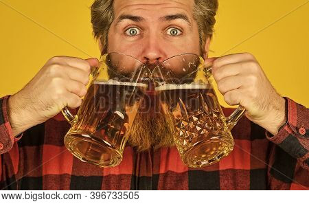 Brutal Bearded Male Drinks Beer From Glass. Beer Pub. Stylish Bartender Or Barman In Bar. Recreation