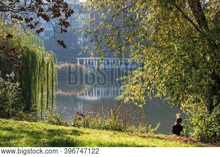 Berlin, Germany - November 7, 2020: Kuno-fischer-platz Gardens On The Side Of Lake Lietzen With A Yo