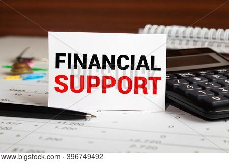 Financial Support Text Written On A Notebook With Pencils.