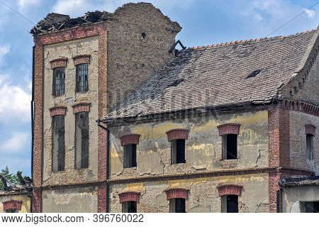 An Old Abandoned Factory That Was Completely Destroyed. The Plant Has Been Abandoned And The Buildin