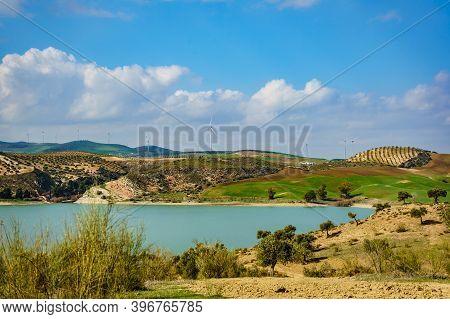 Spanish Hills With Wind Turbines. Lake Embalse Del Guadalhorce, Ardales Reservoir, Malaga Andalusia,