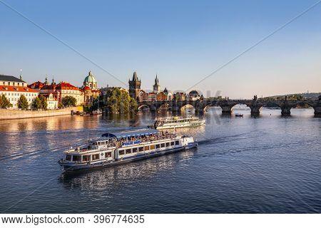Prague, Czech Republic - august 30, 2020: River boats  in Prague, Czech Republic. Charles Bridge