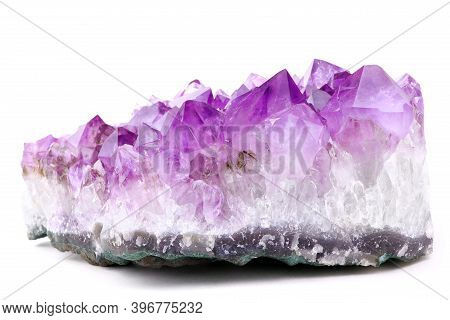 Purple Amethyst Isolated On A White Background. Lilac Mineral Amethyst. Violet Crystal Stone
