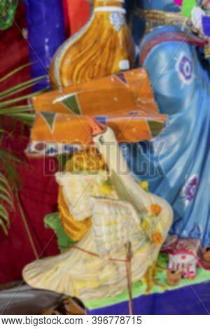 Blurred Image Of Hamsa Or Swan Clay Idol Near Feet Of Goddess Saraswati At Kolkata, West Bengal, Ind