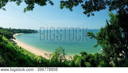 Panorama Image Of Tropical Beautiful Seascape View Of Green Trees With Blue Sea In Background.