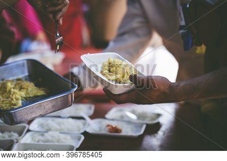 Poor People Get Free Food From Volunteers: Concept Serving Free Food To The Poor