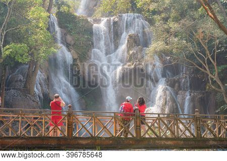 Beautiful Landscape Of Kuang Si Falls An Iconic Waterfalls With A 60 Metres Drop In The Jungle Park